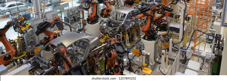 welding of car body. Automotive production line. long format. Wide frame