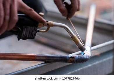 Welding of copper pipe of a methane gas pipeline or of a conditioning or water system.