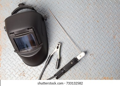 welding equipment on a metal desk with workshop welding mask,welding electrodes, for arc welding. with copy space