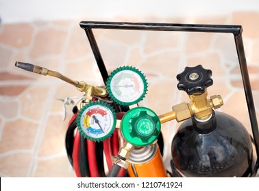 Welding gas cylinder pressure gauge close up. welding equipment acetylene gas cylinder tank with gauge regulators manometers.Welding torch .