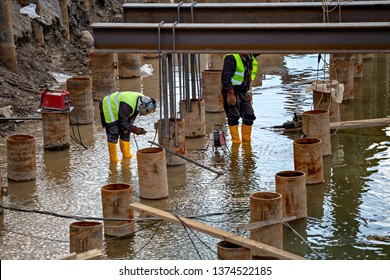 Welding and grinding in wet conditions. Abstract: Dangers of welding around water, not following standard safety procedure.