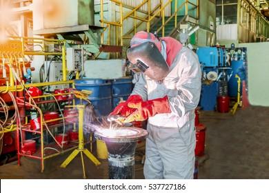 welding man working pipe in factory