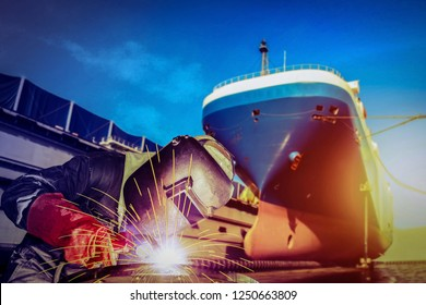Welding MIG worker with spark weld factory at shipbuilding and ship Repairing industrial, wear equipment protective for safety concept on forward ship in shipyard background and vintage tone