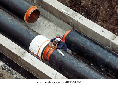 Welding a pipes on a main heating construction site