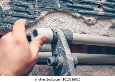 Welding of plastic pipes for a water pipe in the house