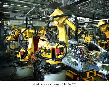 welding robots in a car manufactore
