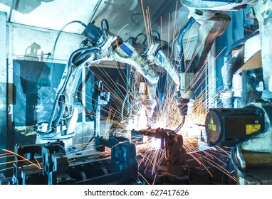 Welding robots movement in a car factory (engineering, factory, manufacturing)