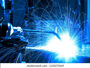 Welding robots movement in factory (manufacturing, industry, factory)