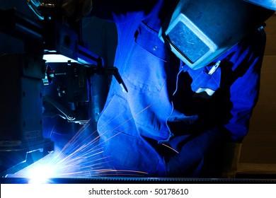 Welding sheet metal into tubes in an engineering workshop