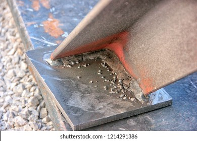 Welding slag. Welding slag is a form of slag or vitreous material produced as a by product of some arc welding processes. This is a slag of the shielded metal arc welding.