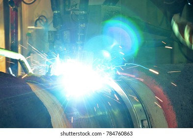 Welding spark from automatic pipeline welding machine