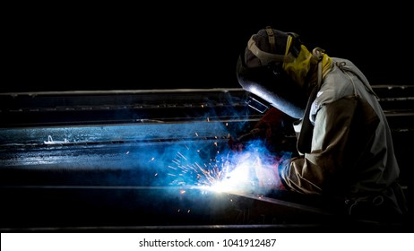 Welding with sparks by Process fluxed cored arc welding , Welding by Welder Thailand , Welder welding steel structure.Industrial steel welder part in factory.
