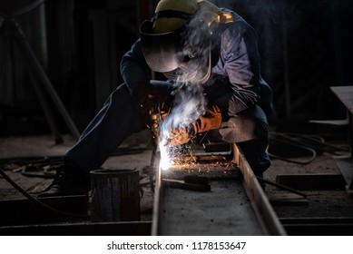 Welding with sparks by Process fluxed cored arc welding ,Industrial steel welder part in factory welder Industrial automotive part in factory.