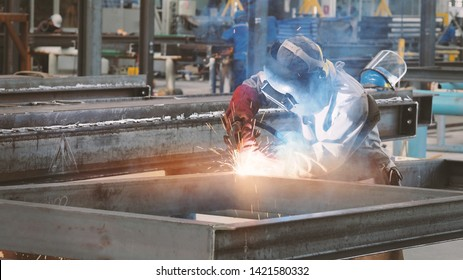 Welding with sparks by Process fluxed cored arc welding in factory , Welding by Welder Thailand,copy space for you text