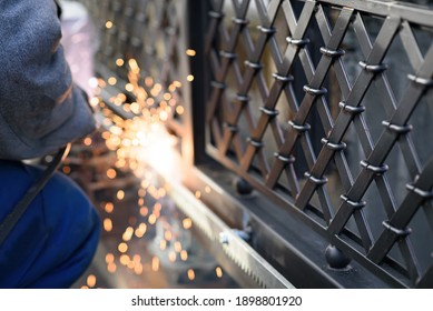 Welding the steel gear racks to gate. Last phase before setting up an automated gate operator. Professional service of installation and maintenance of automatic cantilever sliding gate.