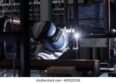 Welding steel pipe with Mig-Mag method for industrial work. Gas metal arc welding