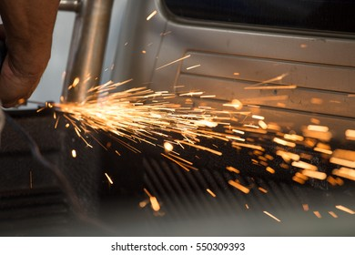 Welding steel with spread spark and lighting around.