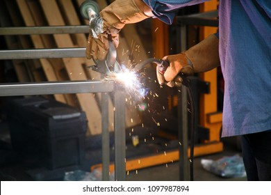 Welding. A welder Arc Welds metal together. Industrial Welding.