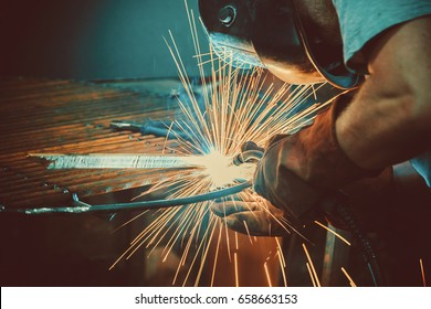 Welding Work. Erecting Technical Steel Industrial Steel Welder In Factory. Craftsman. Soft focus. Shallow DOF