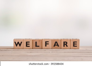 Welfare sign made of wooden cubes on a desk