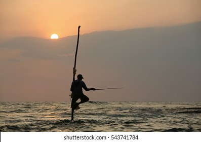WELIGAMA, SOUTHERN PROVINCE/SRI LANKA - FEBRUARY 5th 2010 - A stilt fisherman on his petta at sunset near Weligama in Southern Sri Lanka.