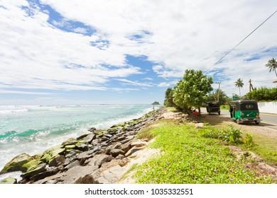 Weligama, Sri Lanka, Asia - DECEMBER 2015 - Tuk tuk drivers having a rest at the coastline of Weligama