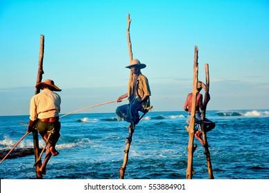 WELIGAMA, SRI LANKA â?? DECEMBER 29: Traditional Sri Lankan stilt fishermen are fishing on December 29 2016 at Weligama in Sri Lanka. Stilt fishing is a method of fishing unique to country of Sri Lanka