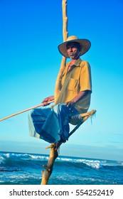 WELIGAMA, SRI LANKA DECEMBER 29: Traditional Sri Lankan stilt fishermen are fishing on December 29 2016 at Weligama in Sri Lanka. Stilt fishing is a method of fishing unique to country of Sri Lanka