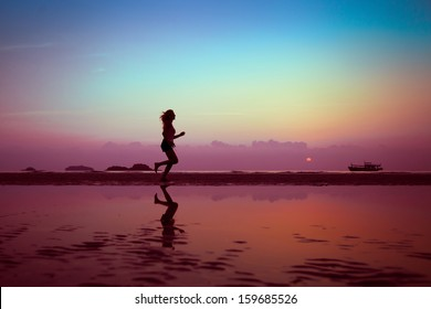 well being or sport background, woman silhouette on the beach
