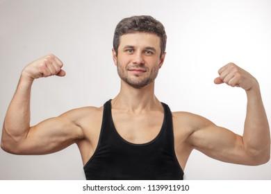 Chubby man posing mucles
