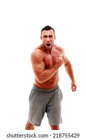 Well built muscular shirtless athletic man screaming isolated on white background