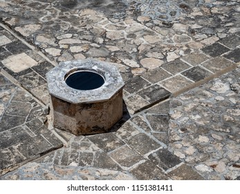 Well in the center of a spanish-colonial style plaza in Mexico
