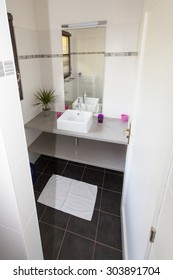 Well decorated modern white  washroom,