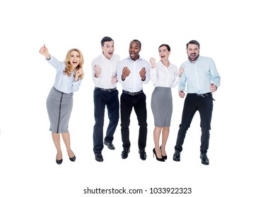 Well done. Good-looking satisfied stylish young successful colleagues smiling and standing together and expressing happiness