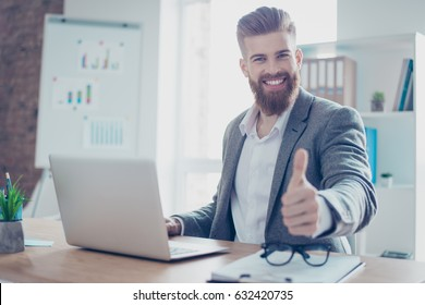 Well done! Successful happy businessman is showing thumb up. He is handsome, smiling, his company achieved the goal