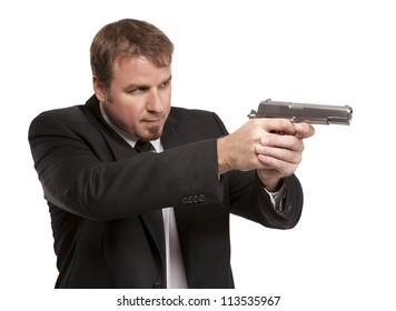 Well dress man aims a pistol