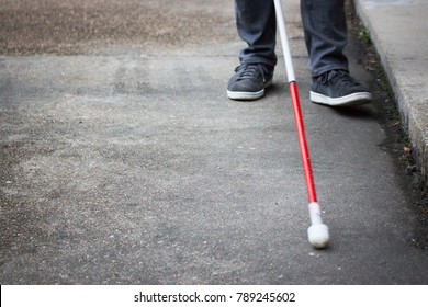 Well Dressed Blind Man Walking Near a Curb with a Long White Cane; Close up on Cane and Feet (Copy Space)