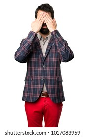 Well dressed man covering his eyes on white background