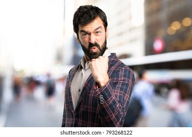 Well dressed man fighting in the city
