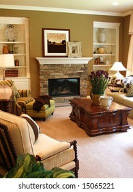 A well furnished family room with a stone fireplace lit by the sunlight