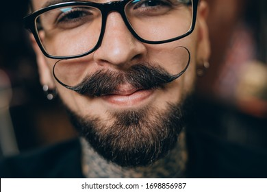 Well groomed hipster. Barbershop concept. Beauty industry. Facial hair care. Mature man bearded hipster with long beard and mustache. Styling mustache. Growing long mustache. Moustache style.