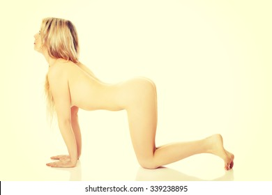 Well groomed woman in bent yoga pose
