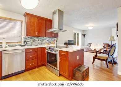 well kept kitchen with hardwood floor and great lighting.