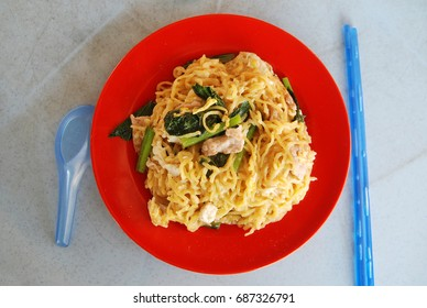 Well known local Sabah Chinese dish named Tuaran Fried Mee served with vegetable and pork. Tuaran noodles are mosty homemade and served in most Chinese restaurant or food stalls.