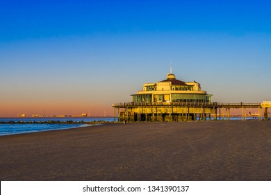 the well known pier jetty of Blankenberge beach, Beglium, Beautiful coast with blue water and a colorful sky during sunset