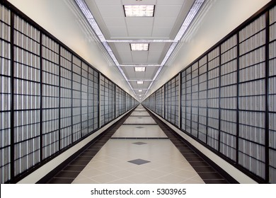 A well lit, infinite long hallway with po boxes - Symmetry.