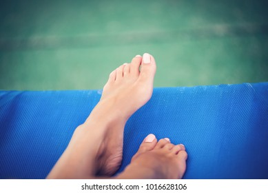 Well maintained female feet on a sunbed.