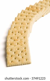 A well placed stack of crackers on a white background