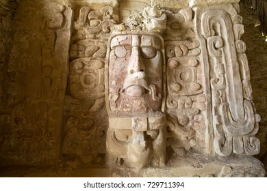well preserved statue on the Temple of the Measks at Kohunlich maya archaeological site in Quintana Roo Mexico