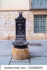 Well preserved and working, very old public water source, made of cast iron, located on Plaza de Santa Ursula square of Valencia city, Spain.